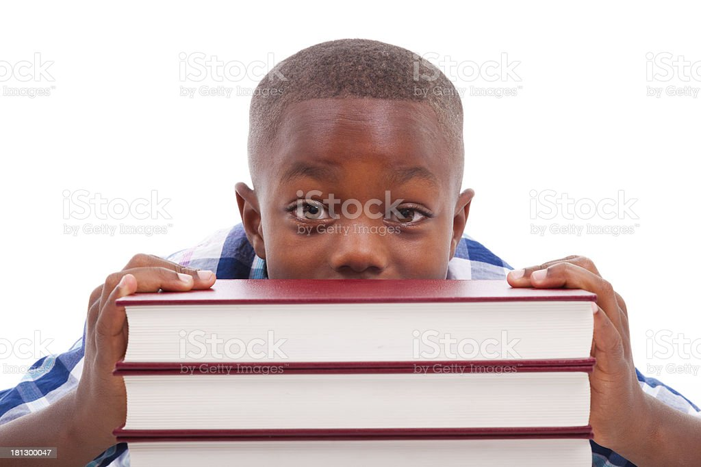 African school boy with stack a book - Black people stock photo