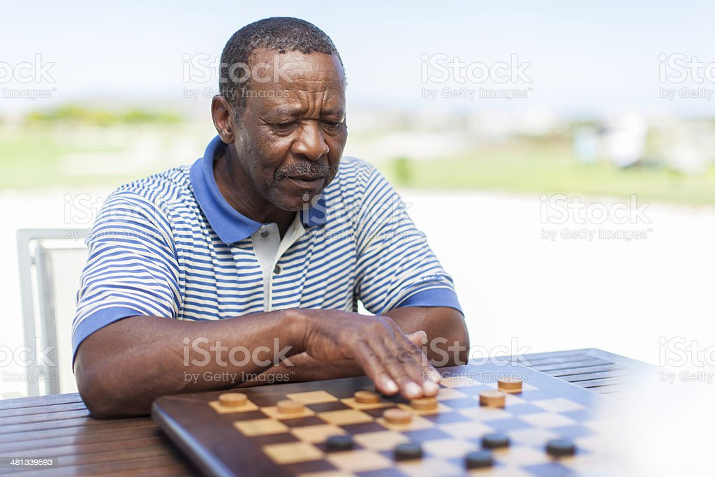 African senior making his move royalty-free stock photo