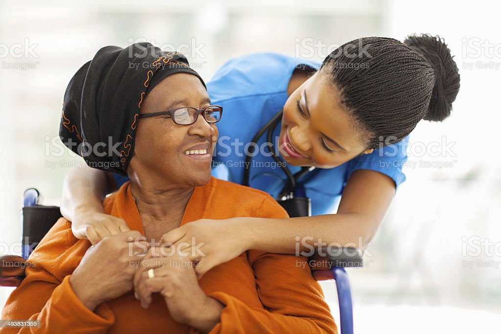 african senior patient with female nurse stock photo