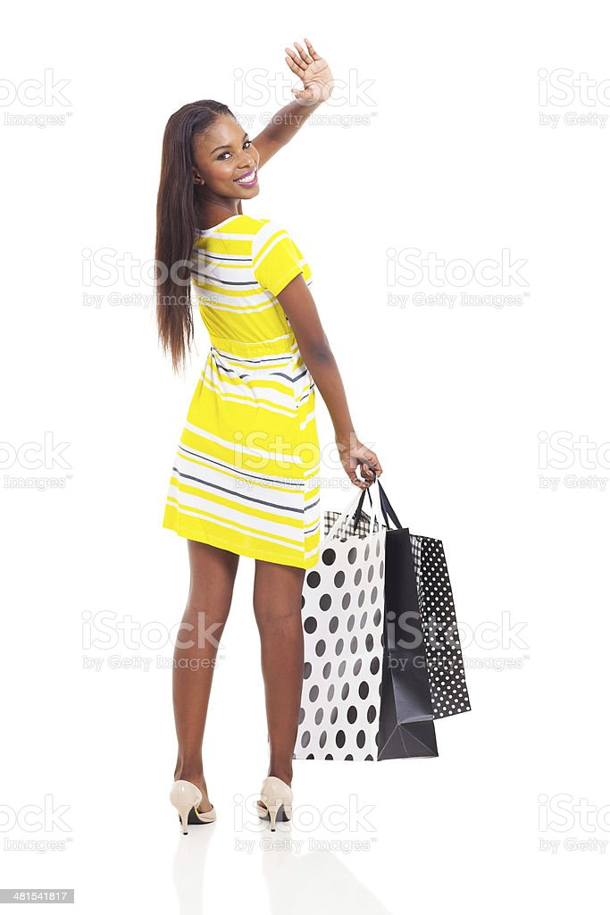 african shopper waving goodbye stock photo