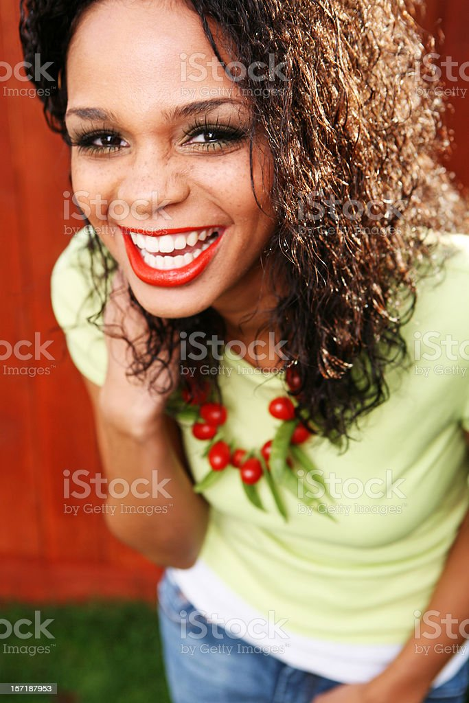 African Smiling Curly Haired Female royalty-free stock photo