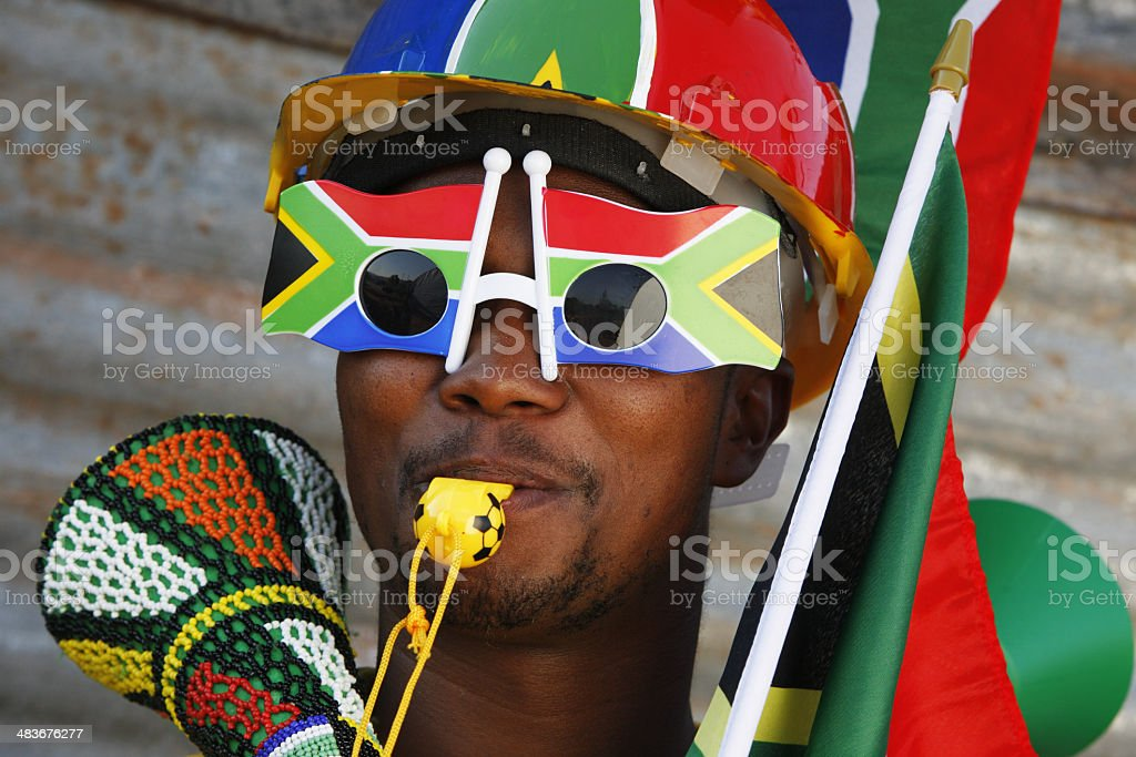 African soccer fan South Africa and Vuvuzela stock photo