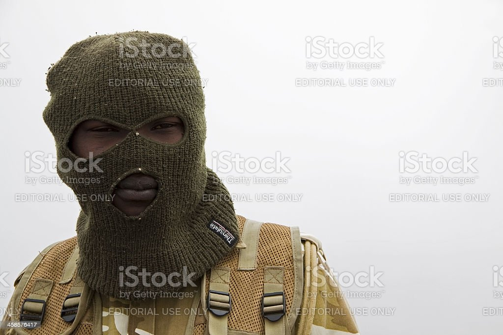 African soldier in balaclava stock photo