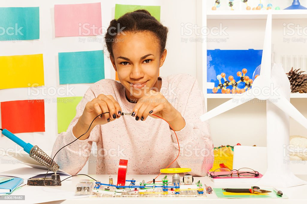 African student completing an electrical circuit stock photo