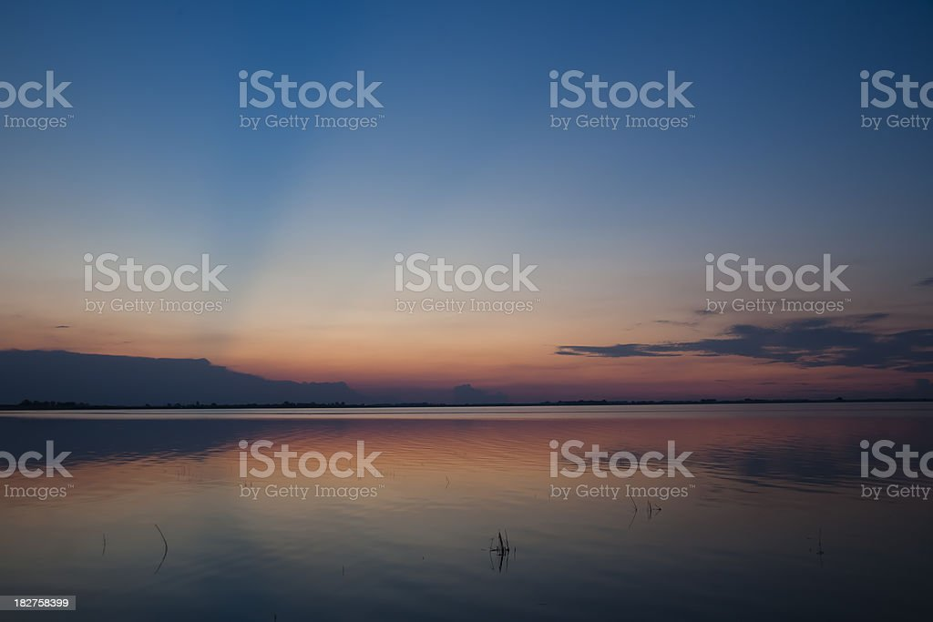 African sunset  with reflections in a lagoon royalty-free stock photo