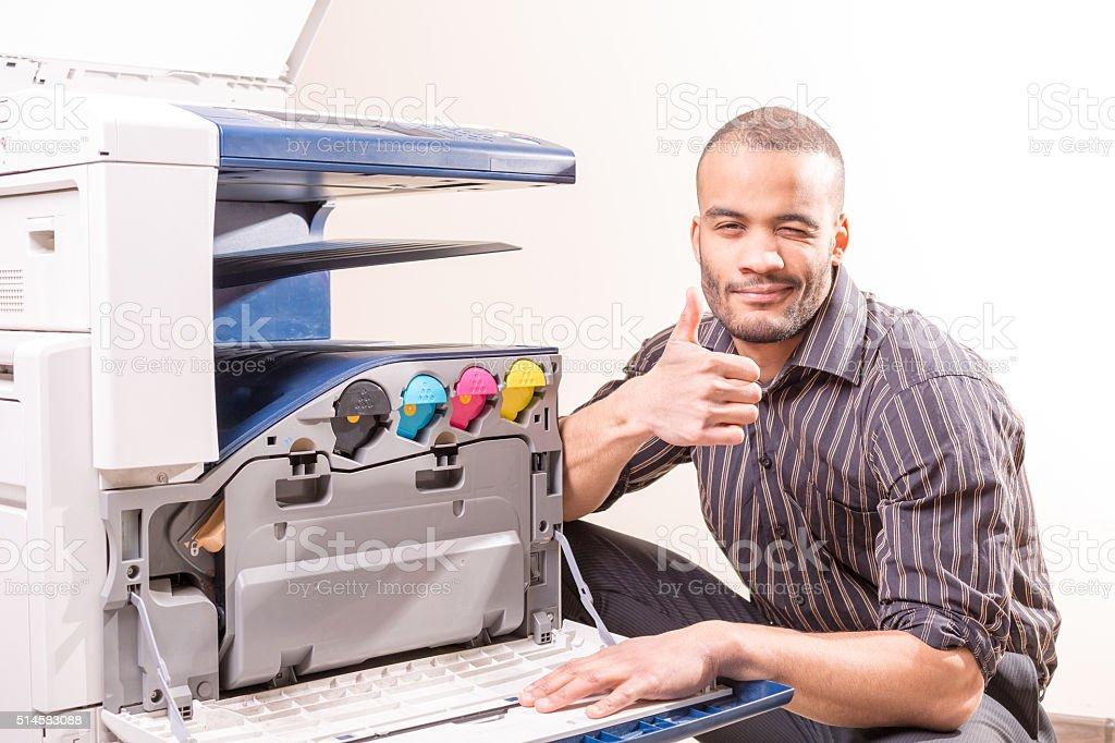 african technician fix office photo copier stock photo