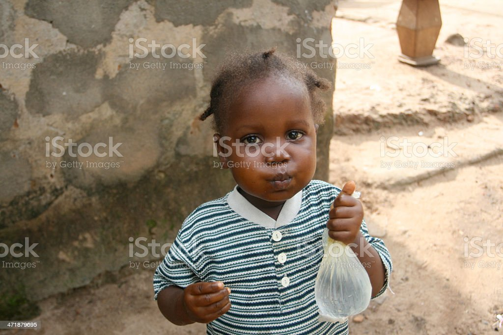 African Toddler Drinking Water royalty-free stock photo