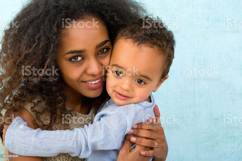 African toddler hugging mom stock photo