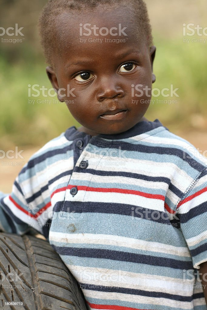 African Toddler with Tire stock photo