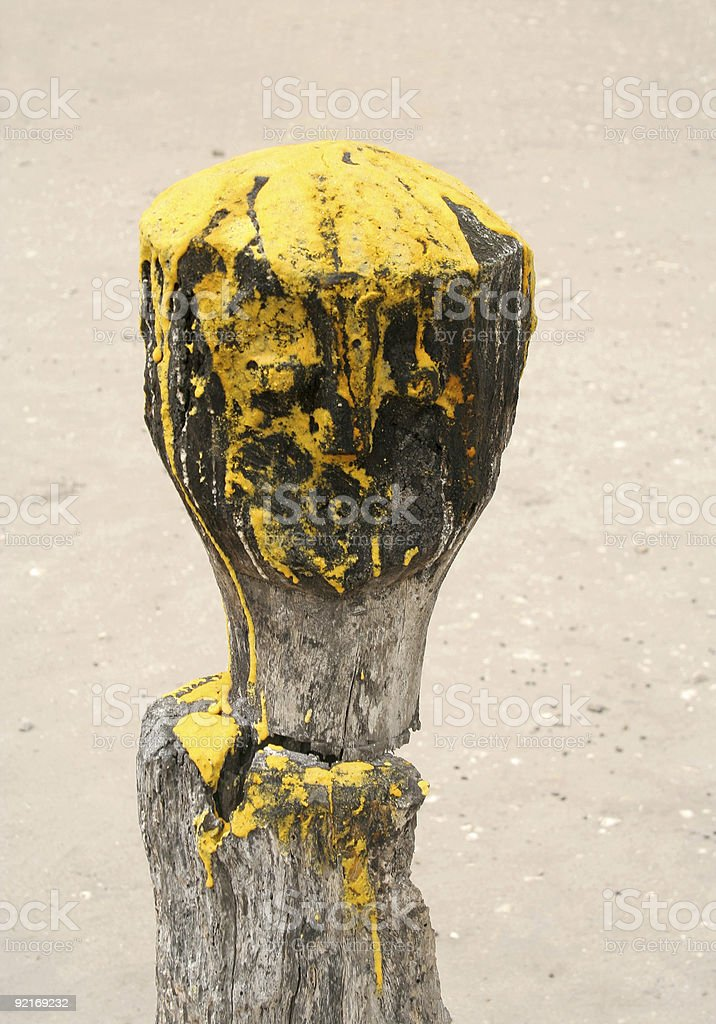 african totem with yellow ceremony color stock photo