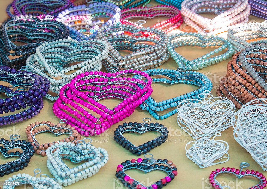 African traditional ethnic handmade colorful beads wire accessories hearts. Craftsmanship. stock photo