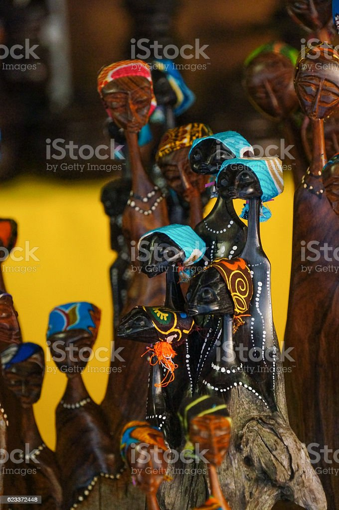 African tribal art for sale at a market stall. stock photo