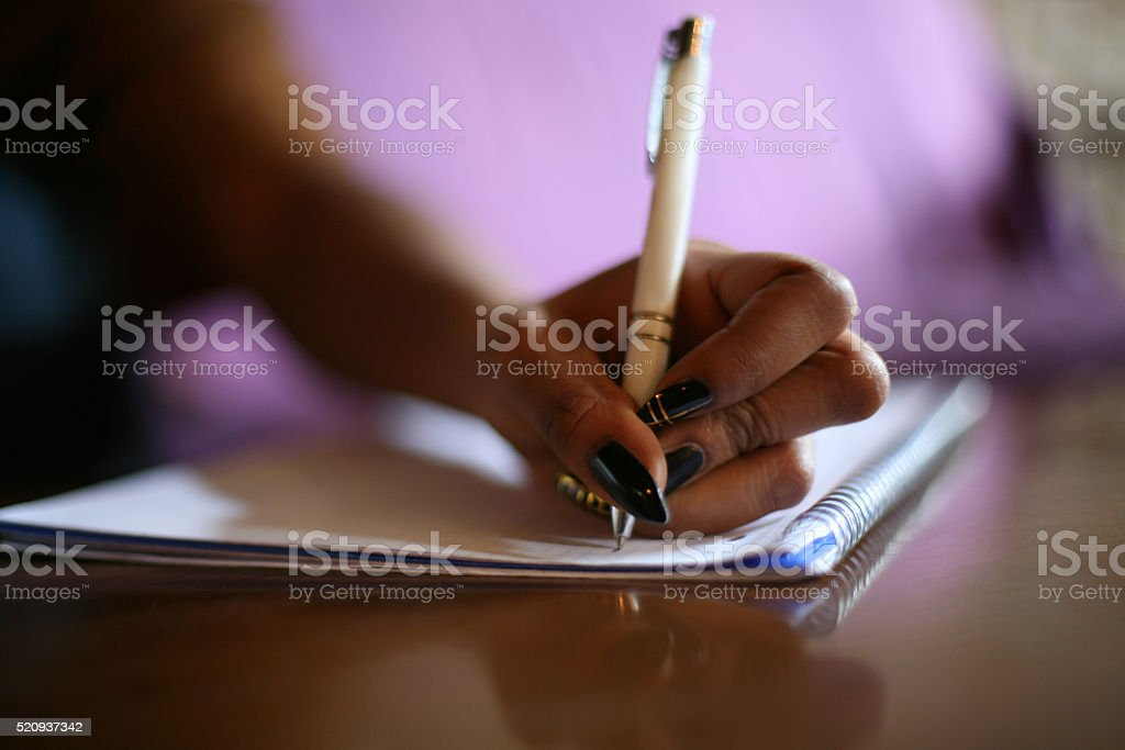 African woman at work from home. stock photo