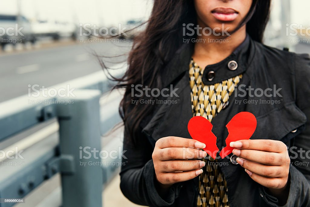 African Woman Broken Heart Disappointed Sad Concept stock photo