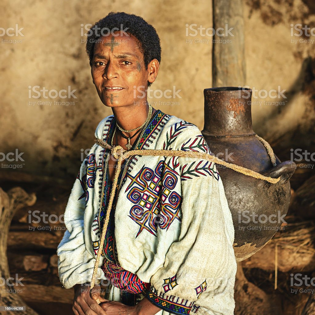African woman carrying water from the river, Ethiopia, Africa stock photo