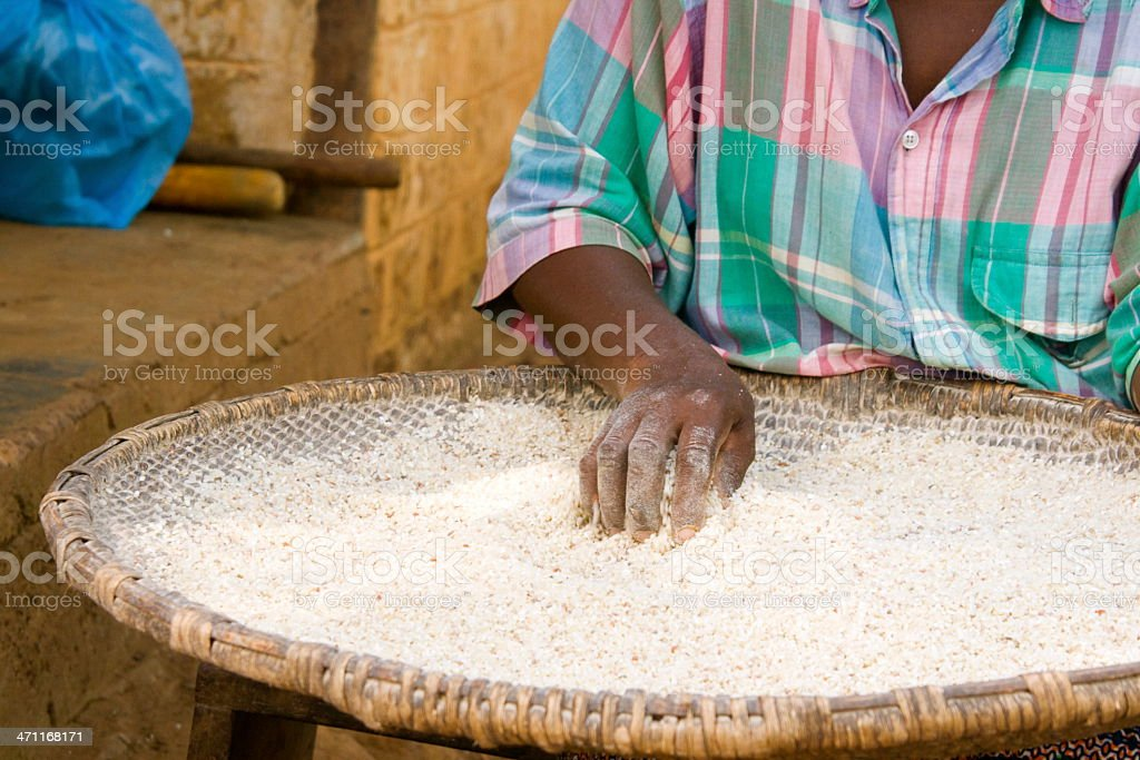 African Woman Cleaning Rice royalty-free stock photo