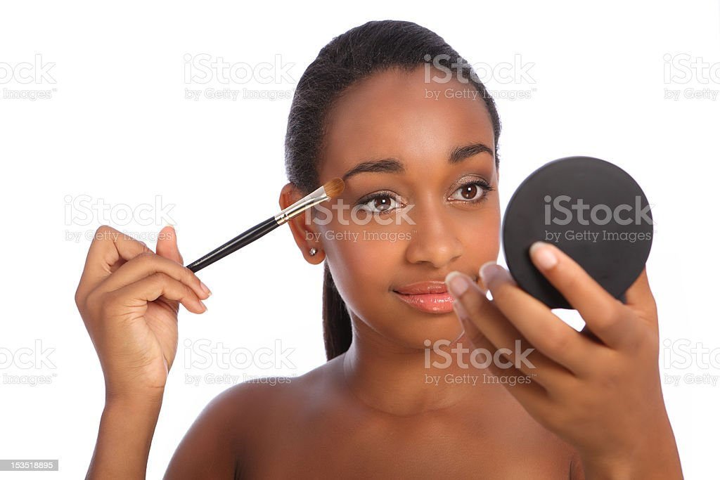 African woman eye shadow make up cosmetics brush royalty-free stock photo