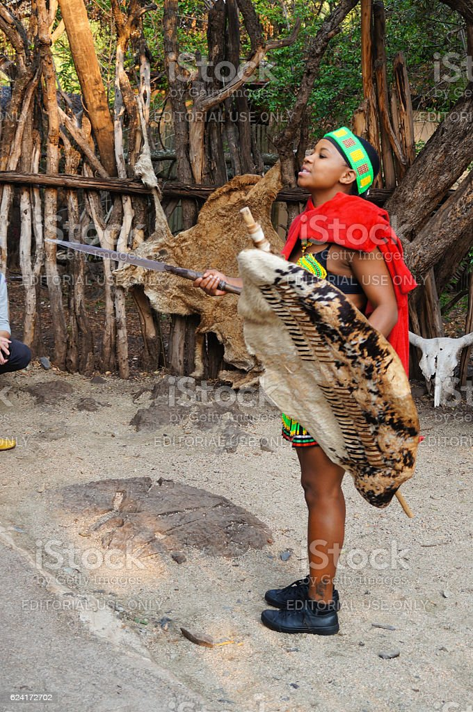 African woman has sword and shield in her hands. stock photo