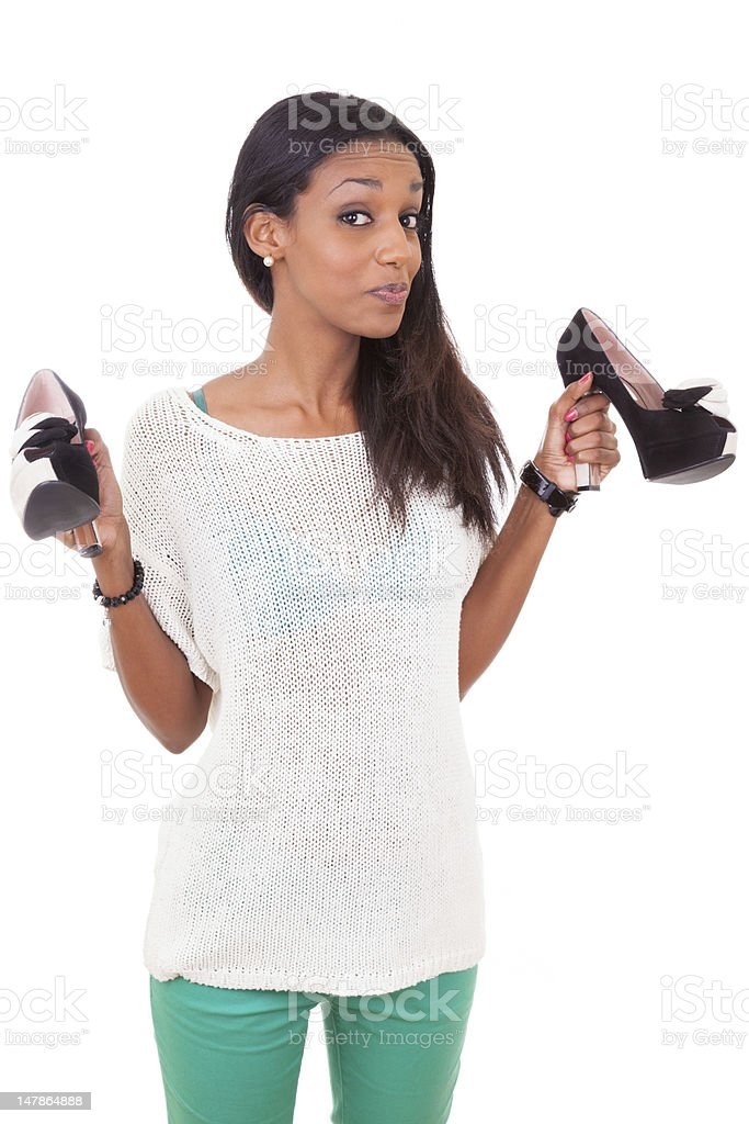 African woman holding a high heel shoe in her hands royalty-free stock photo