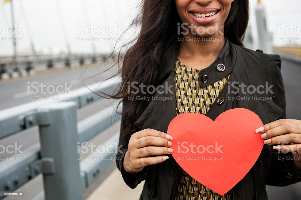 African Woman Holding Heart Shape Symbol Love Concept stock photo