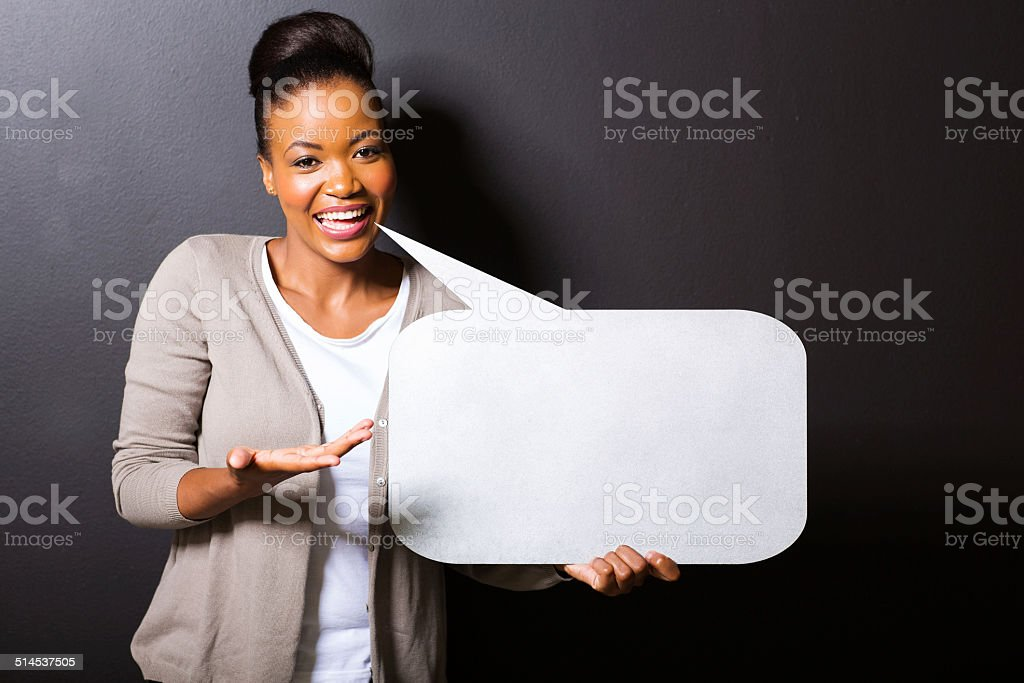 african woman holding speech bubble stock photo