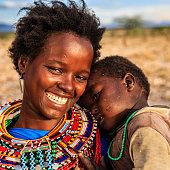 African woman hugging her baby, Kenya, East Africa