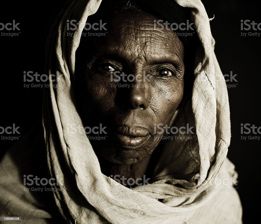 African Woman in a Headscarf - Isolated on Black stock photo