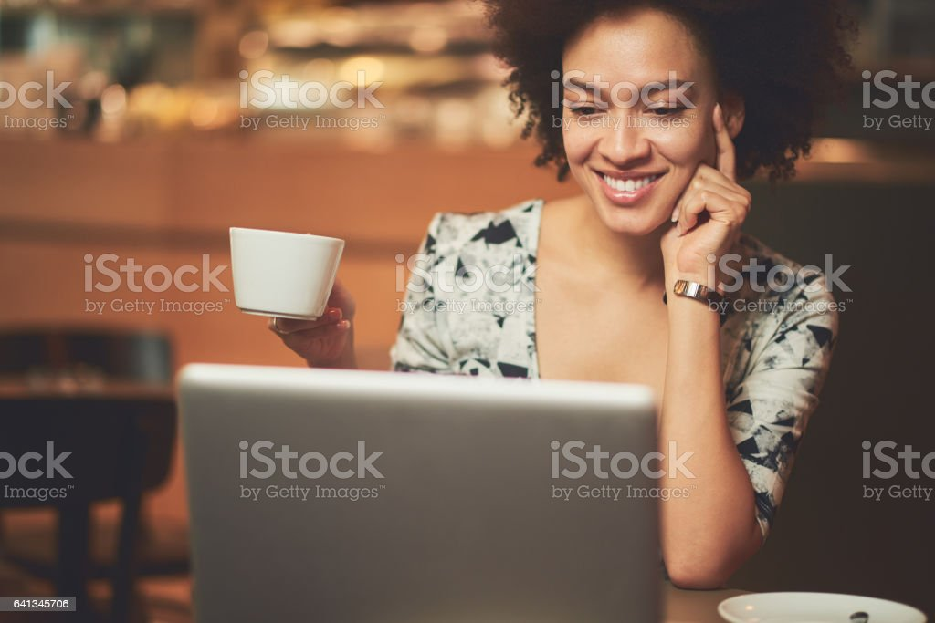 African woman in coffee shop stock photo