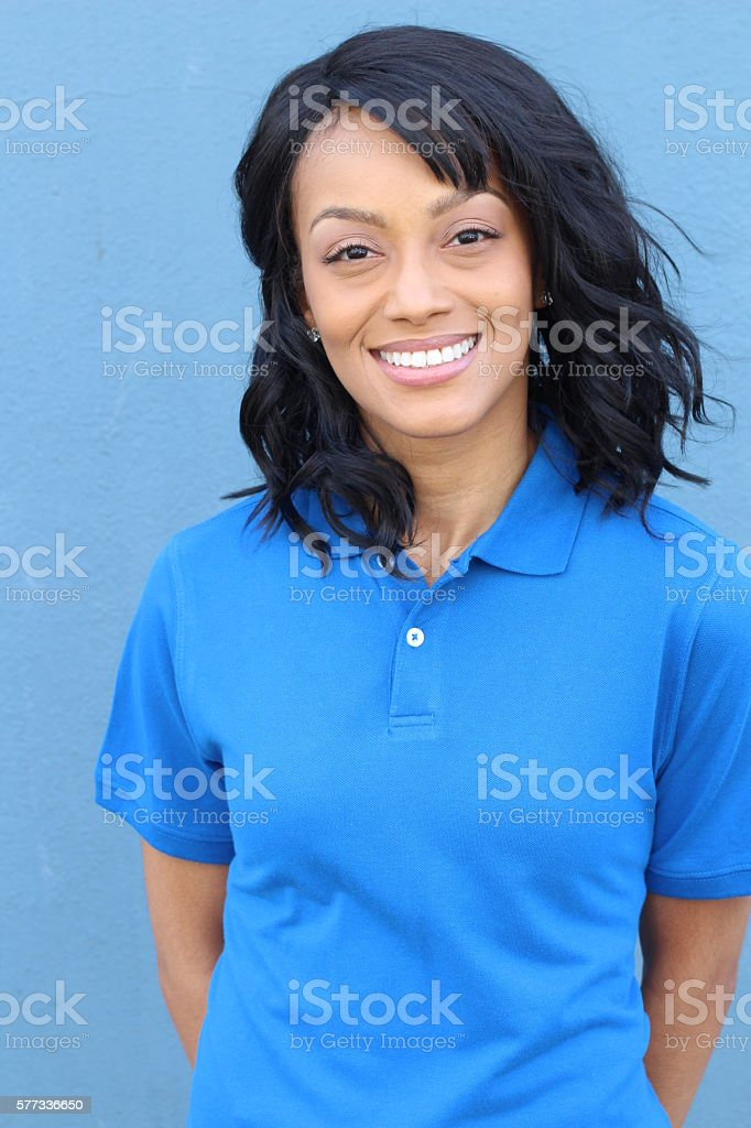 African woman isolated in blue background stock photo
