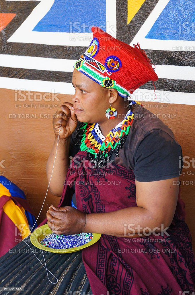 African woman making souvenirs for sell at Lesedi Cultural Village. stock photo