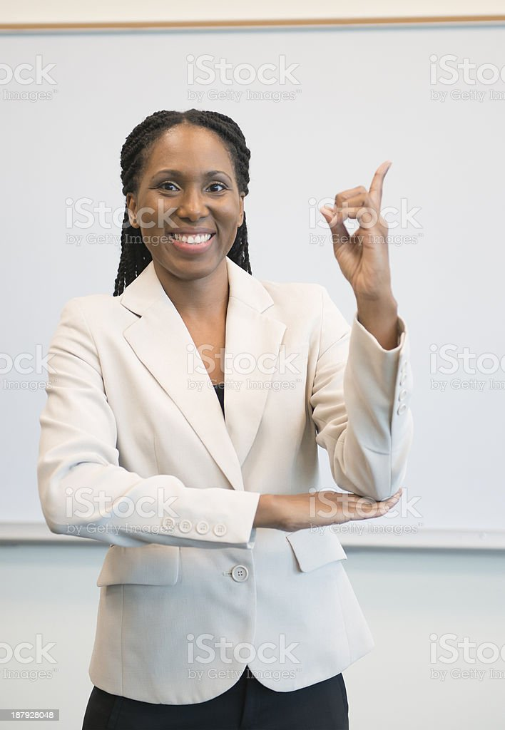 Woman of African descent signing DAY stock photo