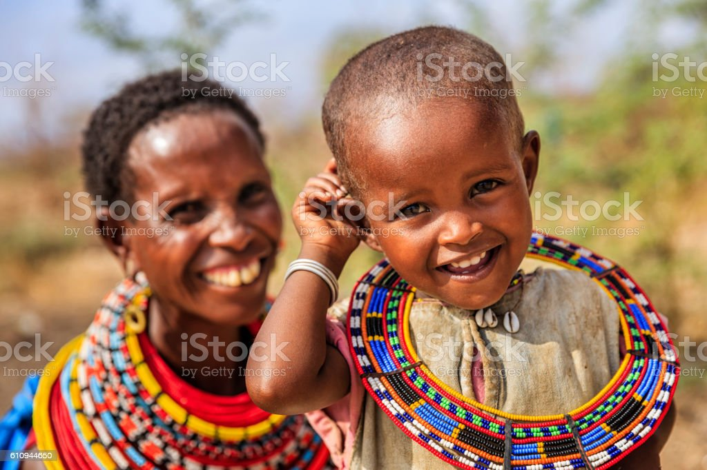 African woman sitting with her baby, Kenya, East Africa stock photo