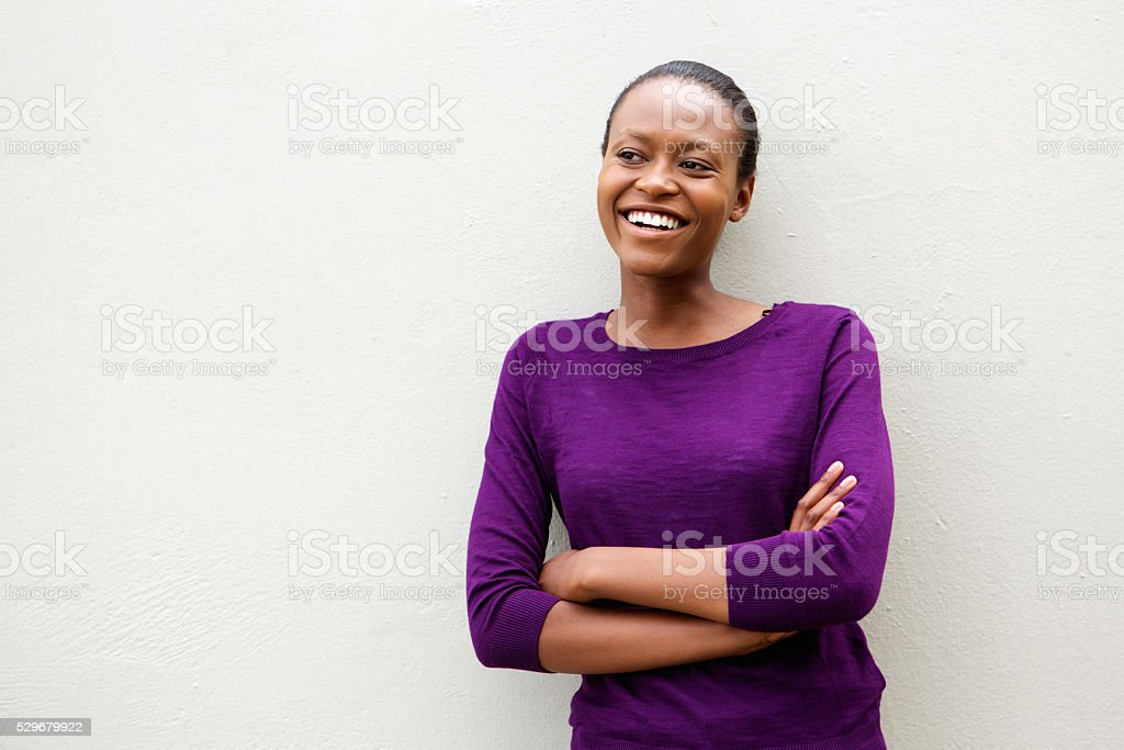 African woman standing with her arms crossed stock photo