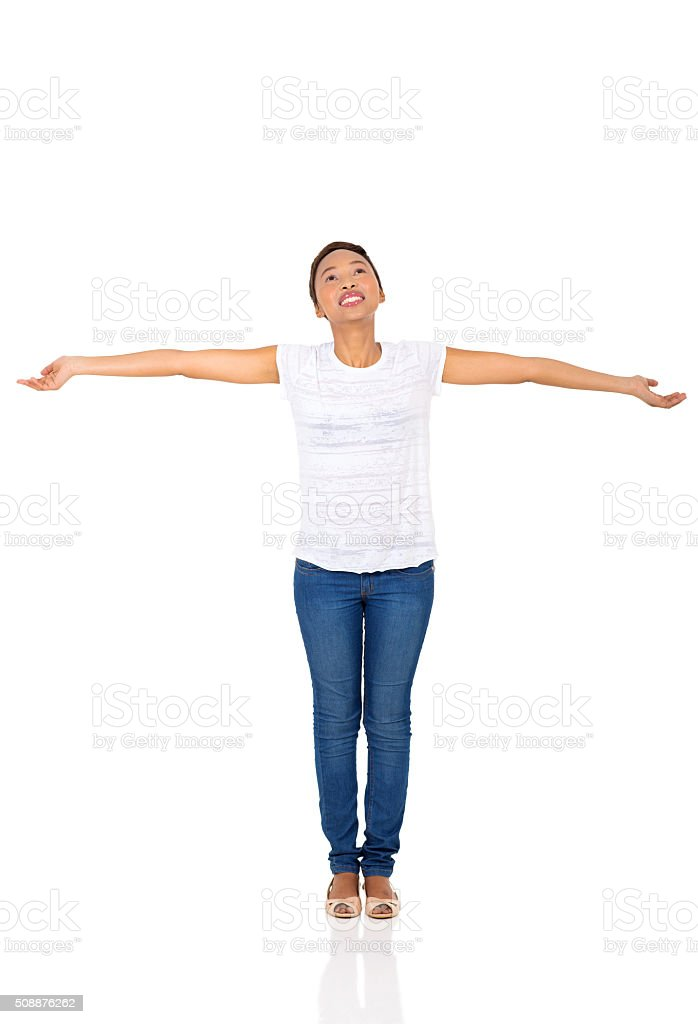 african woman with arms outstretched stock photo