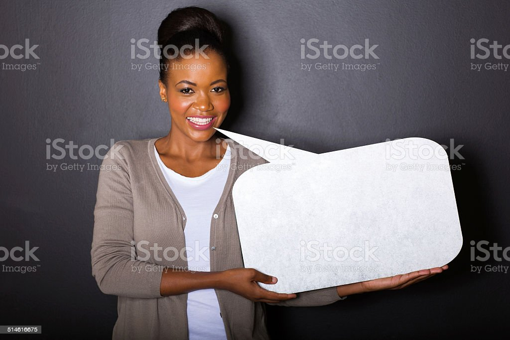 african woman with blank text bubble stock photo