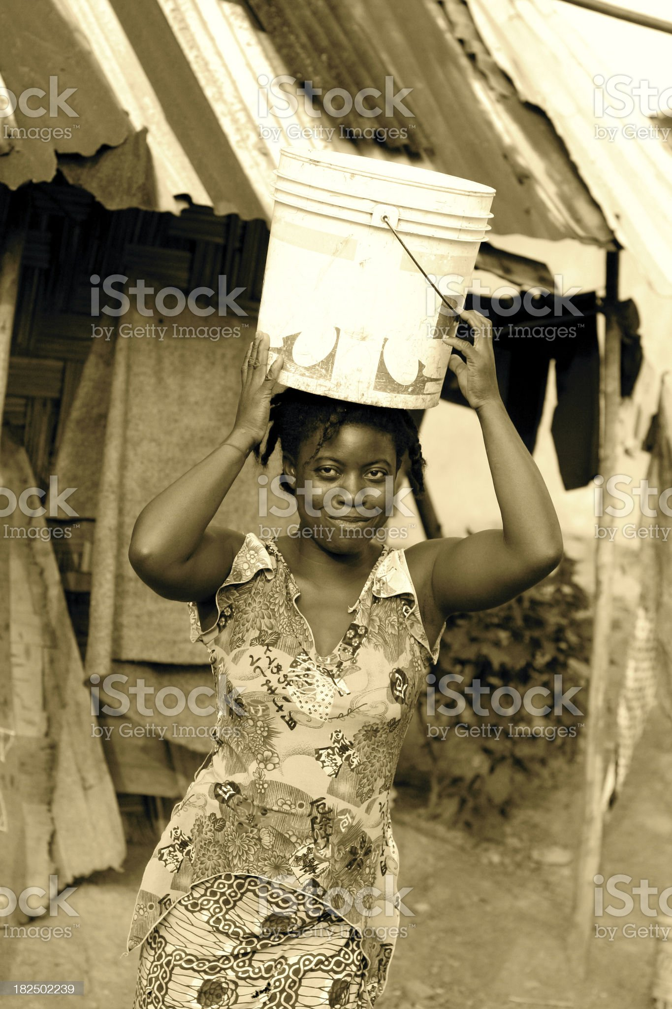 African Woman with Bucket royalty-free stock photo