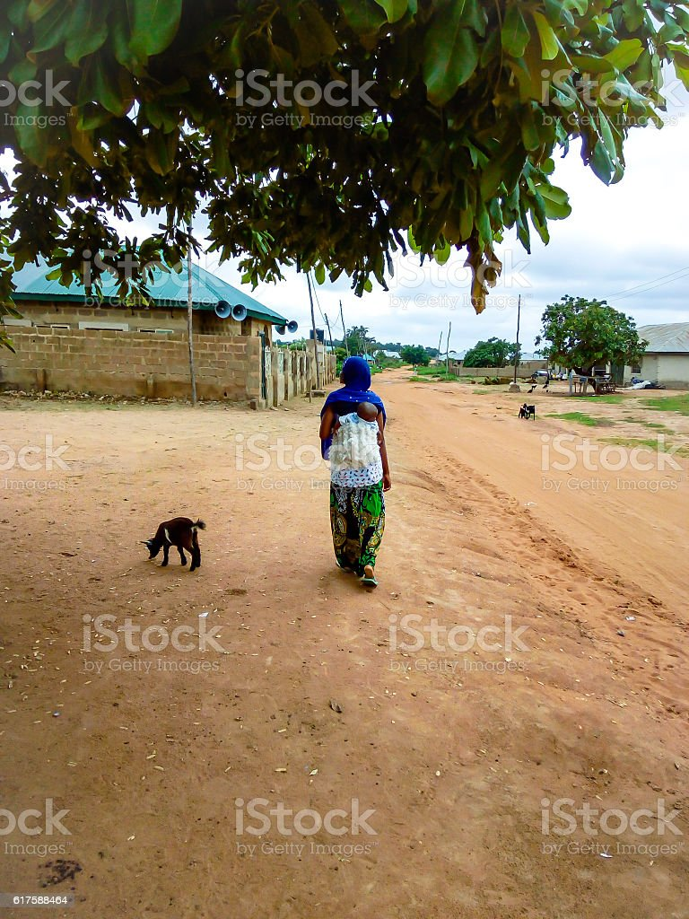 African woman with child on her back stock photo