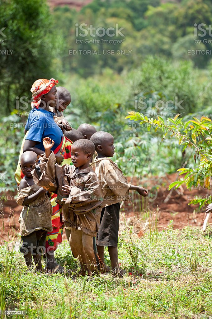 African woman with her children in a field, Burundi, Africa royalty-free stock photo