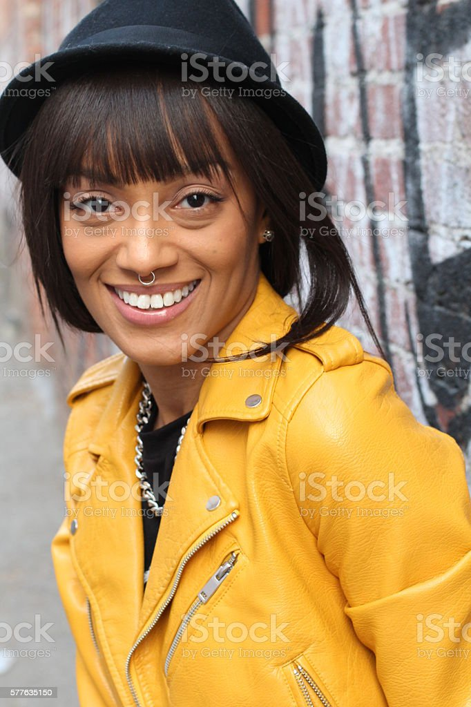 African woman with nose ring and necklace stock photo