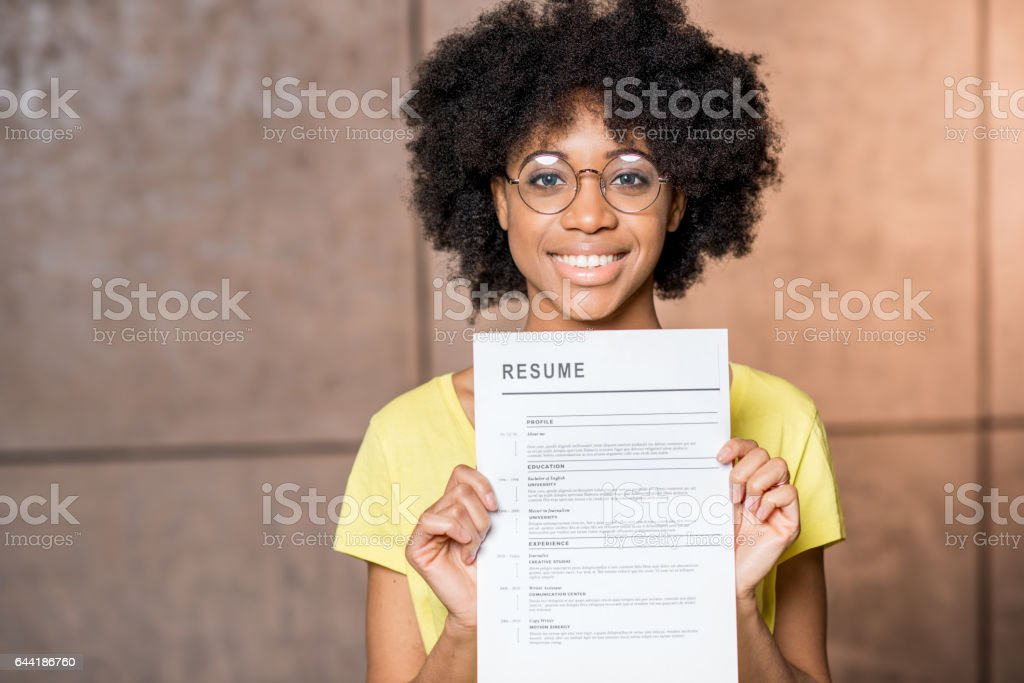 African woman with resume stock photo