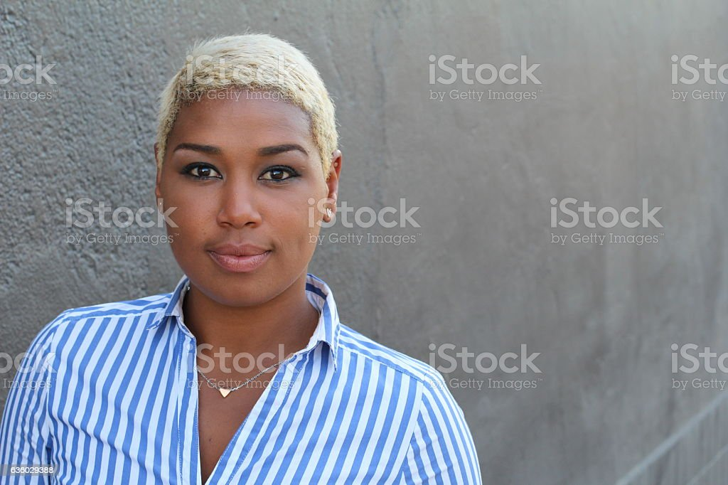 African woman with short dyed blond hair stock photo