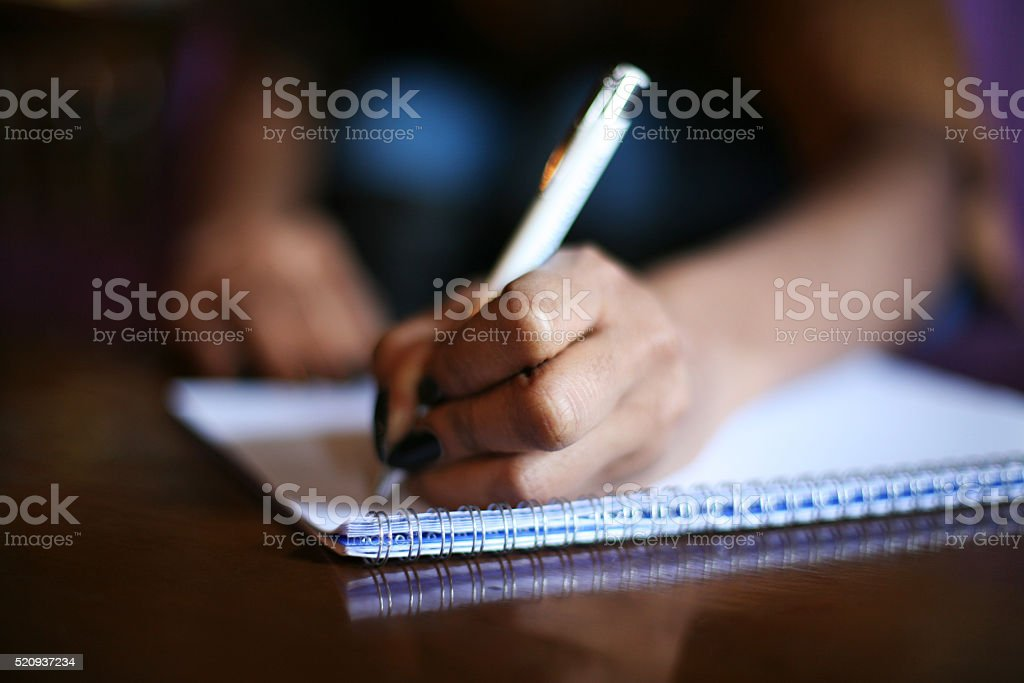African woman writing. stock photo