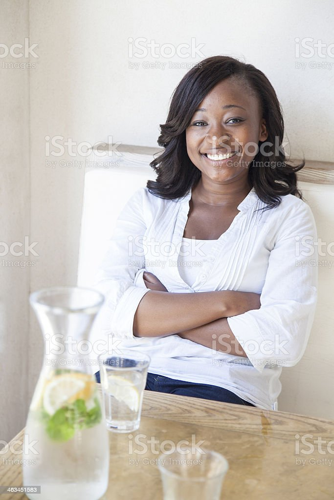 African women in a restaurant looking at the camera. royalty-free stock photo