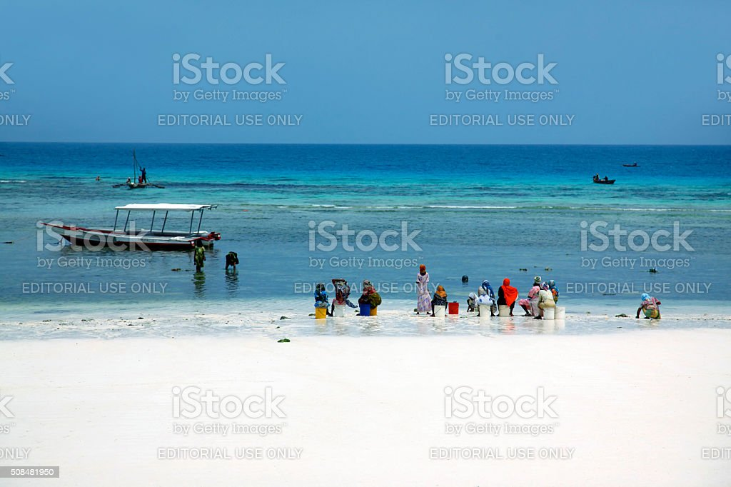 African women in traditional dress on the beach stock photo