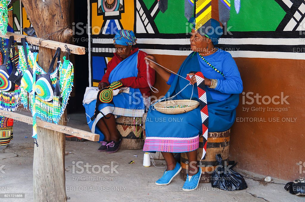 African women making souvenirs for sell at Lesedi Cultural Village. stock photo