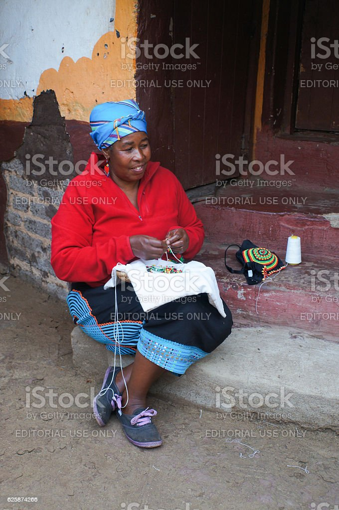 African women making souvenirs from beads for sell,South Africa. stock photo