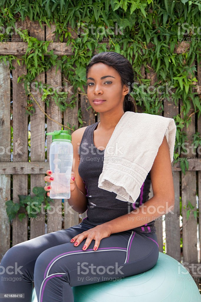 African women resting after her workout. stock photo