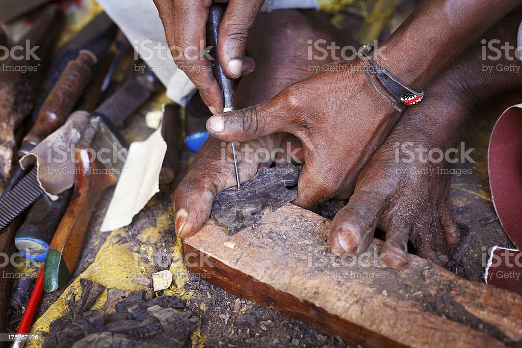African woodcarver stock photo