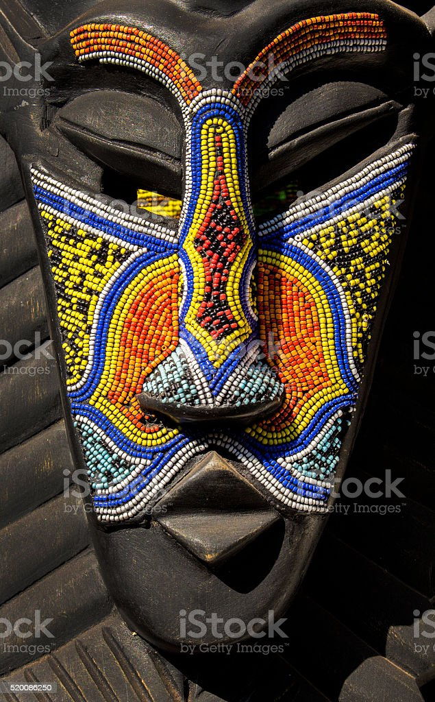 African wooden ethnic tribal ritual mask decorated beards. stock photo