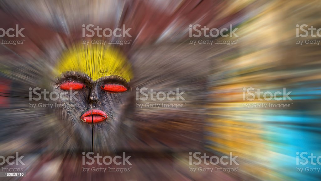 African wooden mask background blur stock photo